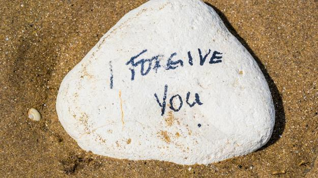 Isolated Stone with written proverb message on it - stock photo