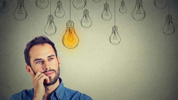 A man thinking. There is a cartoonized lightbulb in the picture.