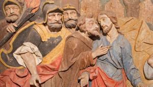 Classical art showing Jesus kissing Judas just before Judas betrays Christ